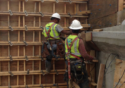 two men setting concrete framing