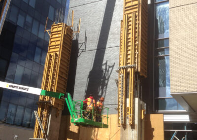 construction lift in front of a commercial building